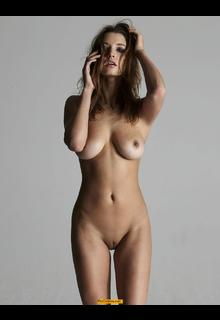 Alyssa Arce exposes her natural boobs and shaved pussy posing full frontal nude for Treats! magazine