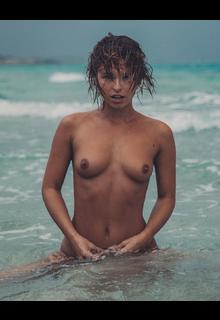 Marisa Papen topless in a water