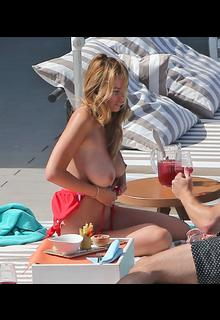 Rhian Sugden changing on a beach shows her big nude boobs