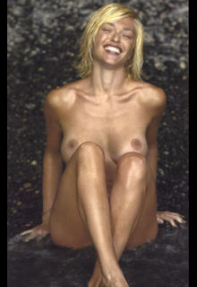 Italian TV hostess and actress Paola Barale sitting nude