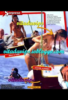 Italian television presenter, television personality, showgirl actress and former singer Alba Parietti topless on a boat paparazzi collage