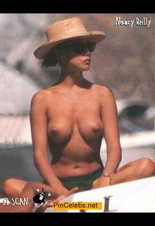 Nancy Brilli topless in a hat on a boat paparazzi photo