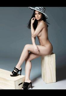 Emeraude Toubia sitting naked