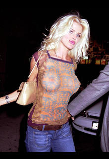 Victoria Silvstedt braless in see through top