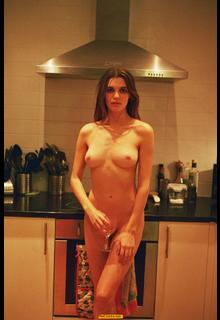 Lola McDonnell fully nude in a kitchen