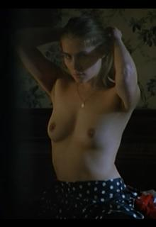Emmanuelle Seigner topless in Le sourire